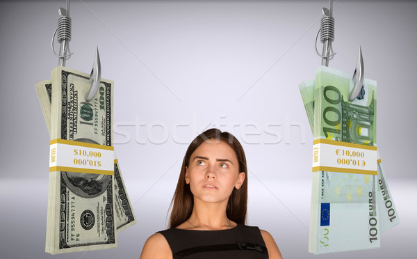 Businesslady looking at money Stock photo © cherezoff