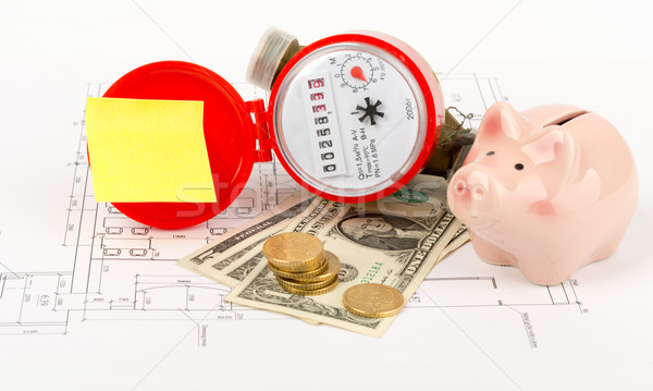 Water meter with piggy bank and cash on draft Stock photo © cherezoff