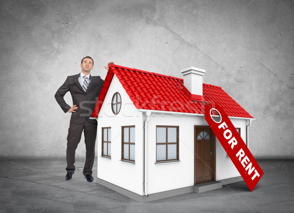 Businessman with house for rent Stock photo © cherezoff