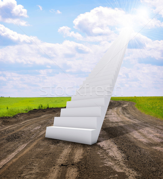 Stairs in sky with green grass, road and clouds Stock photo © cherezoff