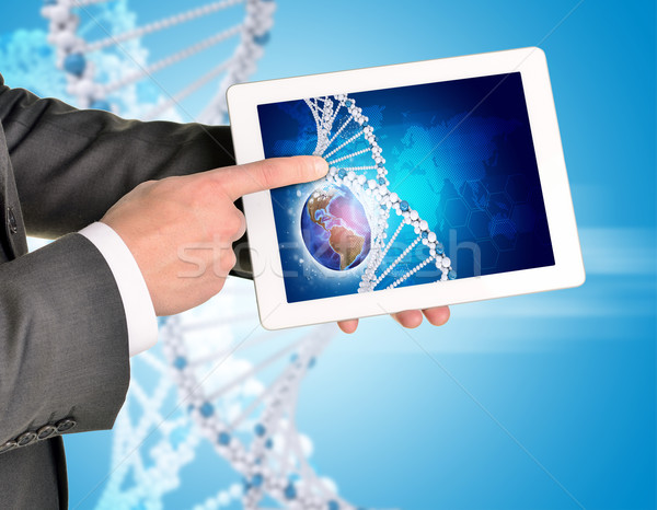 Man hands using tablet pc. Image of Earth and DNA helix on screen Stock photo © cherezoff
