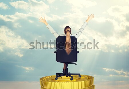 Businesswoman sitting on office chair her arms extended Stock photo © cherezoff