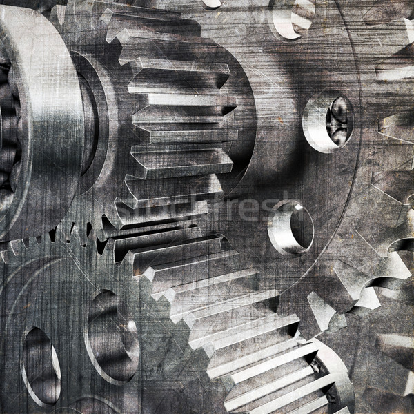 Stock photo: Metal cog gears joining together