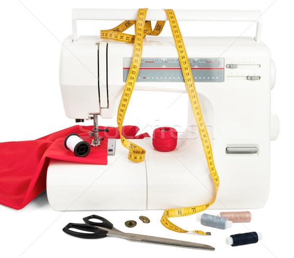 La máquina de coser tejido tijeras rojo aislado blanco Foto stock © cherezoff