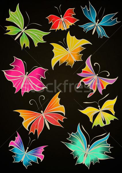 Butterflies black backdrop Stock photo © cherju