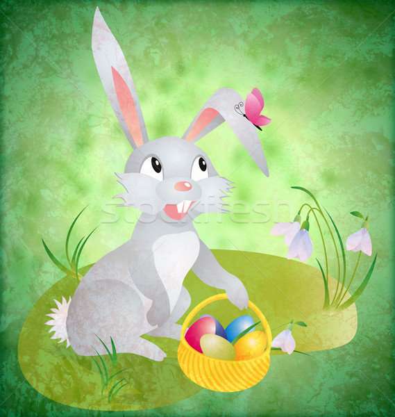 easter bunny with busket and eggs on green grunge backdrop with  Stock photo © cherju