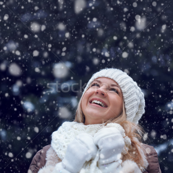 happy woman under snowfall Stock photo © chesterf
