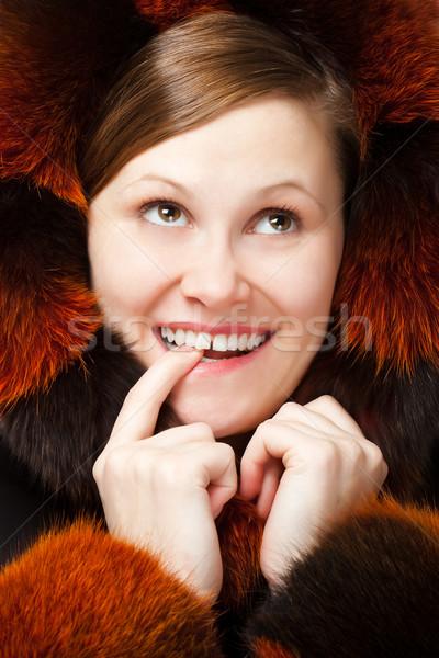 Gülen sinsi gülümseyen kadın kürk eller Stok fotoğraf © chesterf