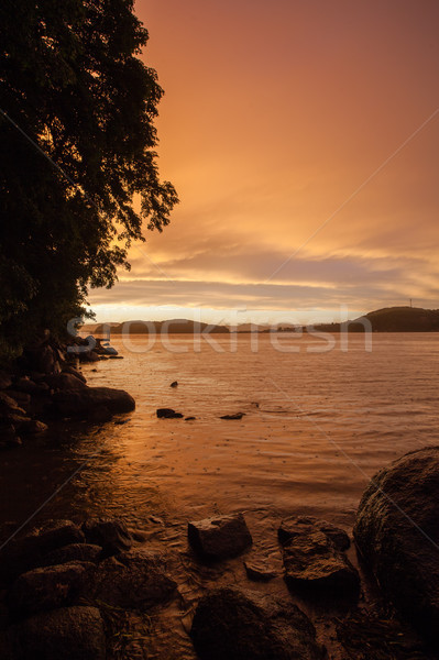 dramatic sunset skies in the sea bay Stock photo © chesterf