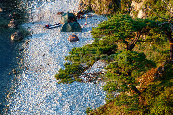 Camping with many tents on the beach at the seaside Stock photo © chesterf