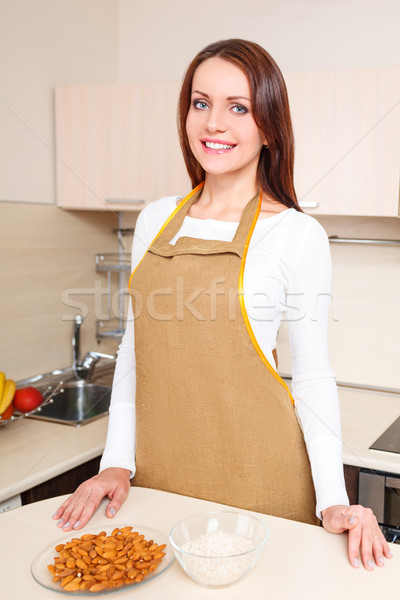 woman at kitchen standing near plate of oatmeal Stock photo © chesterf