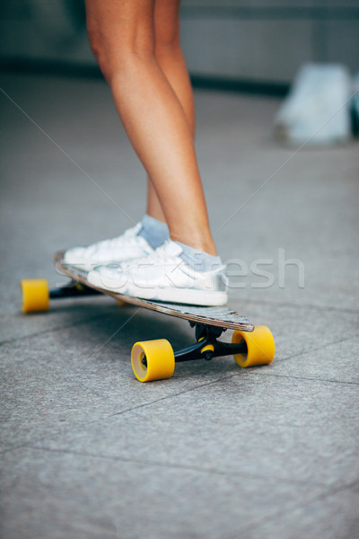 no face girl skating on a longboard outdoors Stock photo © chesterf