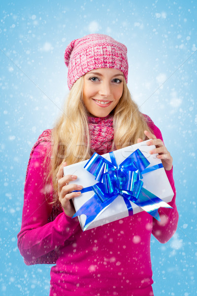 woman wearing knitwear holding giftbox Stock photo © chesterf