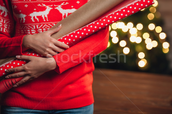 woman hands closeup holding wrapping kraft paper for gifts Stock photo © chesterf