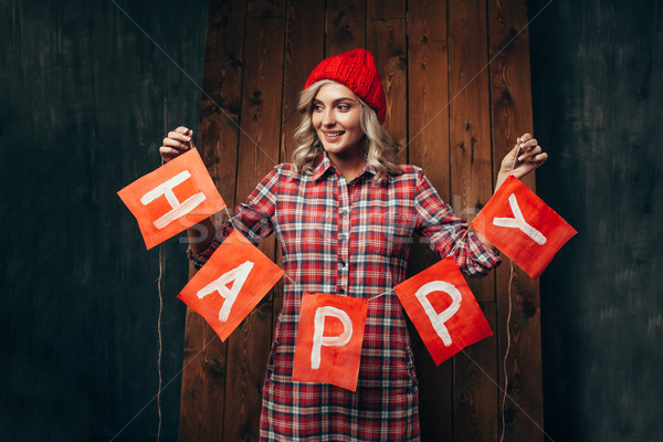 blonde woman holding flags wirh word happy Stock photo © chesterf