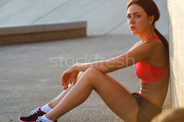 portrait of a sports woman relaxing after workout Stock photo © chesterf