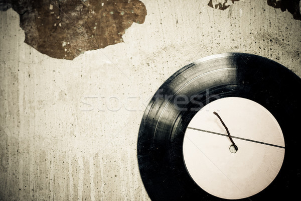 antique vinyl disc on the wall Stock photo © chesterf