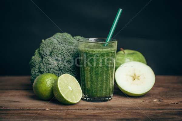 Smoothies and ingredients - avocado, apple, lime, celery, cucumber, broccoli, wooden rustic table ba Stock photo © chesterf