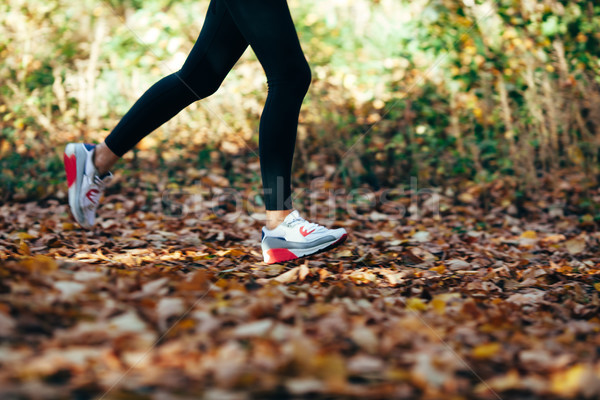 woman runs for fall foliage, shoes closeup, motion blur Stock photo © chesterf