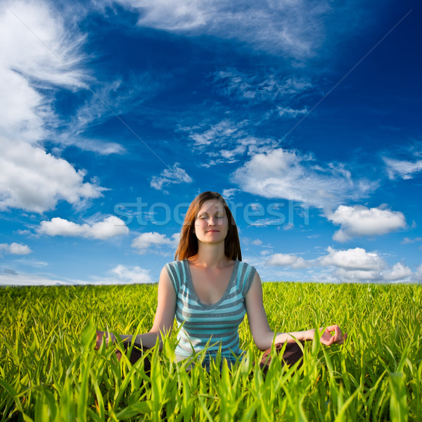 woman meditating on field Stock photo © chesterf