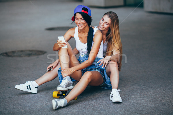 two young adult women with lonboard Stock photo © chesterf