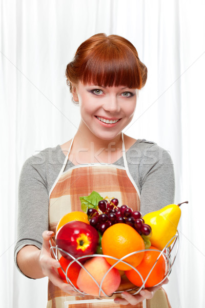 ginger housewife holding fruits Stock photo © chesterf