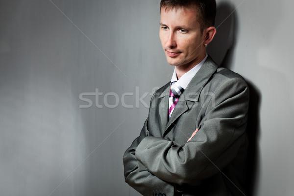 thinking businessman portrait near wall Stock photo © chesterf