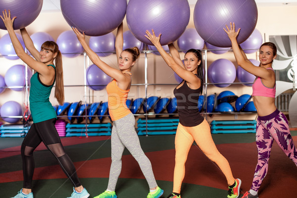 group of woman rising up fitballs Stock photo © chesterf