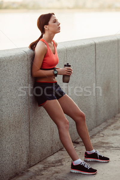Female runner with bottled Stock photo © chesterf