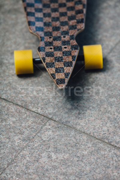 longboard standing on granite pavene Stock photo © chesterf