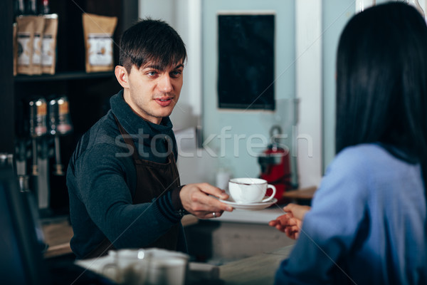 barista with beard hands takeaway coffee to customer  Stock photo © chesterf