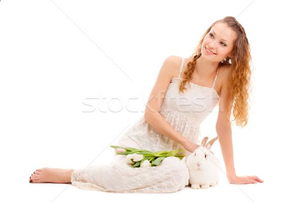 Mutlu kadın oturma zemin lale tavşan Stok fotoğraf © chesterf