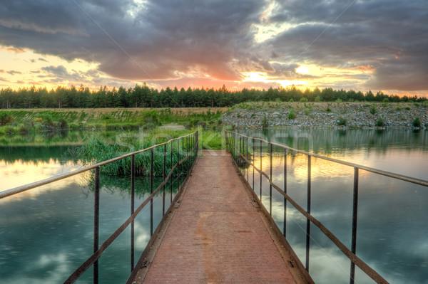 Foto stock: Velho · enferrujado · ponte · pôr · do · sol · céu · estrada