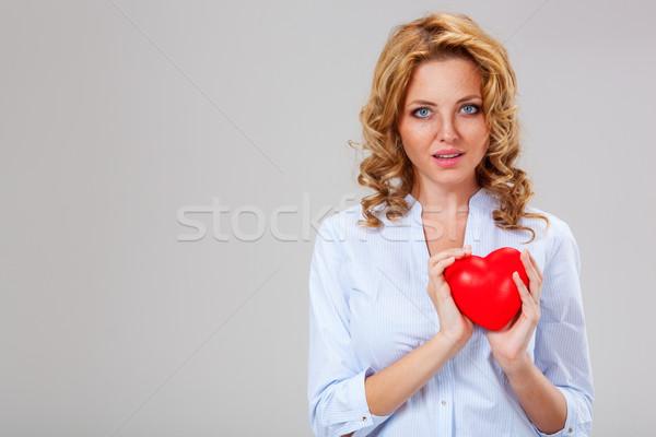 woman holding red heart symbol stock photo © Vasily