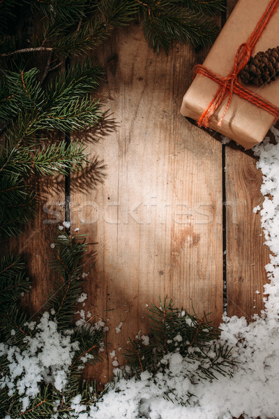 gift box and fur tree on wooden background Stock photo © chesterf