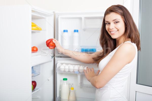 Сток-фото: женщину · перец · холодильник · красный · Sweet
