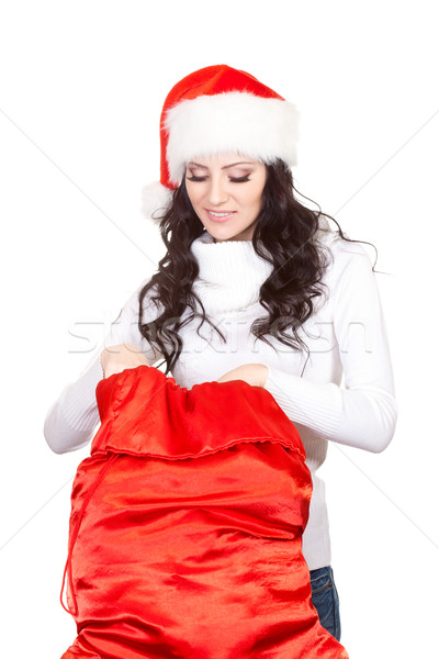 woman looking for surprise in the sack Stock photo © chesterf