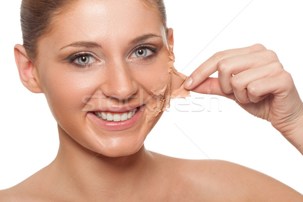 woman taking off her skin from face Stock photo © chesterf