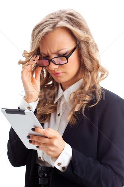 thoughtful businesswoman working with tablet Stock photo © chesterf