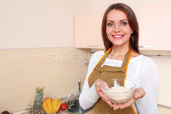 happy young woman at kitchen holding plate of oatmeal Stock photo © chesterf
