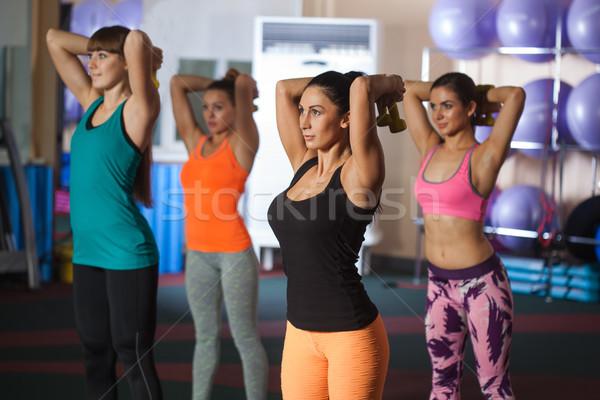 Groupe quatre femmes haltères gymnase main Photo stock © chesterf