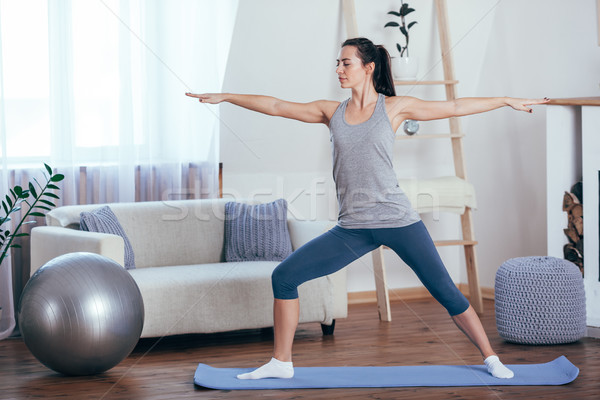 Young cheerful attractive woman practicing yoga Stock photo © chesterf