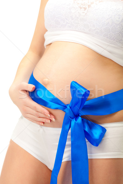 pregnant woman belly with blue bow Stock photo © chesterf
