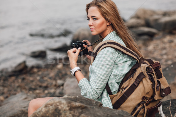 Girl takes photographs with vintage photo camera Stock photo © chesterf