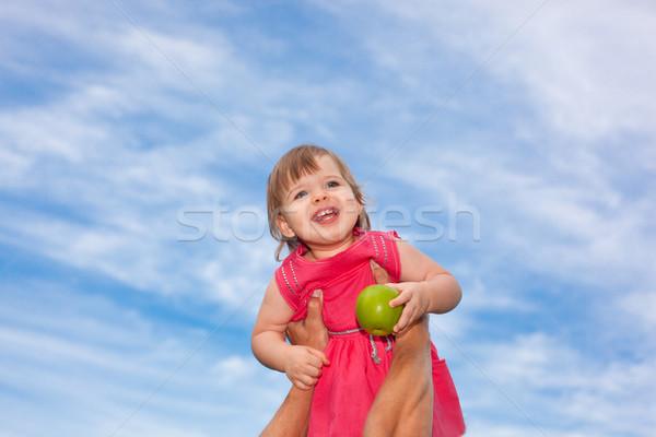 little baby girl over blue skies Stock photo © chesterf