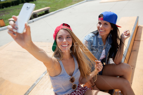 girlfriends taking a selfie photo on the skate park Stock photo © chesterf