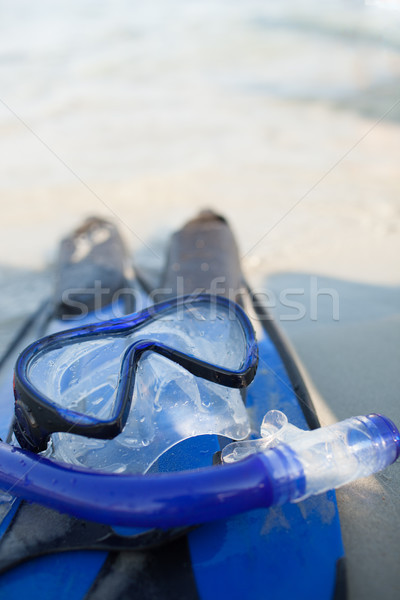 mask and flippers on sand Stock photo © chesterf