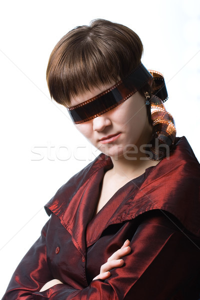 serious woman with fim strip on eyes Stock photo © chesterf
