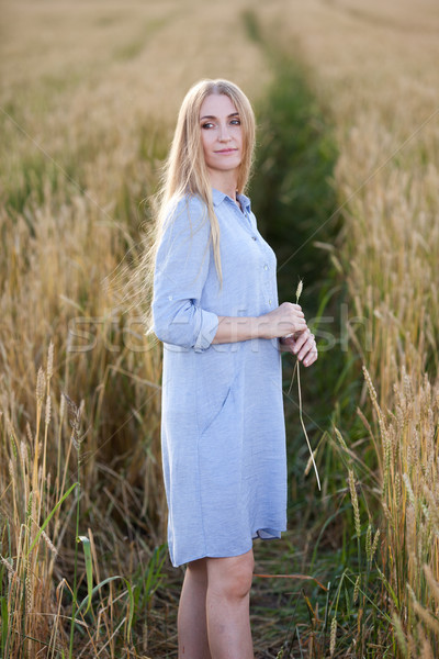 beautiful blonde middle age woman outdoors Stock photo © chesterf
