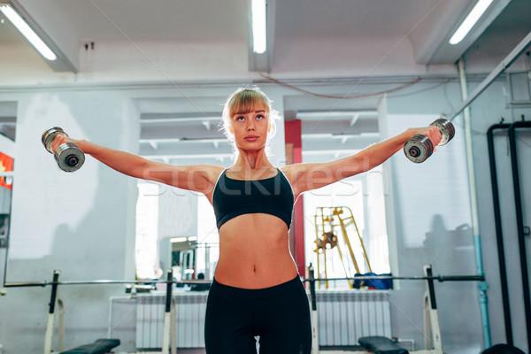 женщину гантели спортзал вверх Сток-фото © chesterf